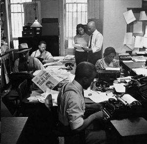 Black journalists working in a newsroom in the 1960s